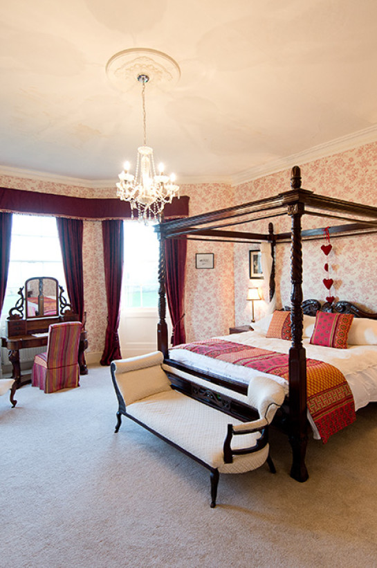 The bridal suite is the principal bedroom at Burton Court. The views stretch over the width of the county from the Bromyard Downs to Hay Bluff.