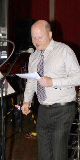 Edward Simpson doing some announcements at an event